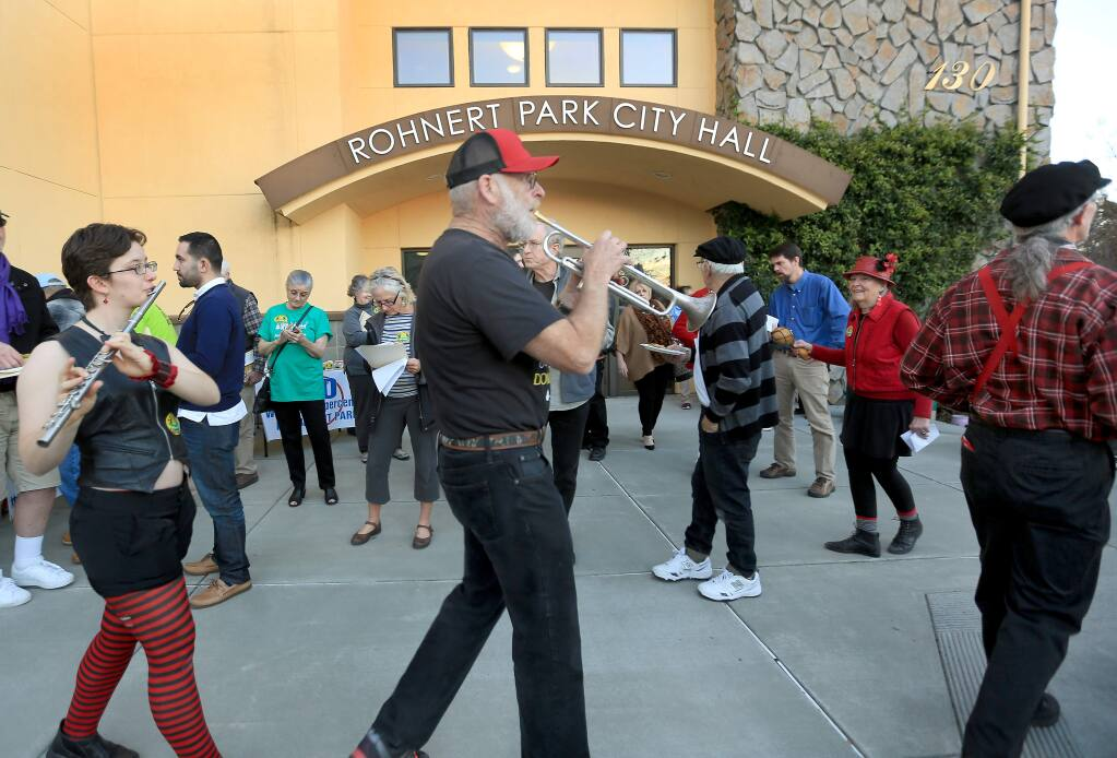 During a small protest outside the Rohnert Park City Hall, Tuesday Jan. 13, 2015, the Hubbub Club band march in line as they help protest against a possible yes decision from the city council on the expansion of Wal-Mart in Rohnert Park. (Kent Porter / Press Democrat) 2015