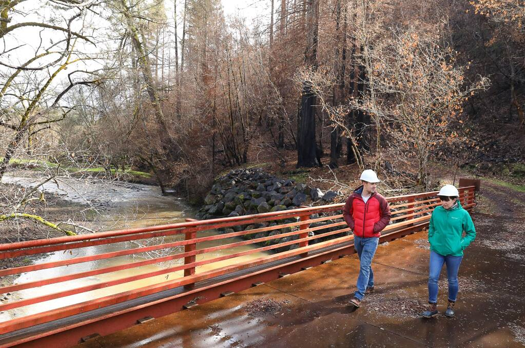 Sonoma County Agricultural Preservation and Open Space District associate planner Fraser Ross and community relations specialist Amy Ricard tour part of the district's land along Mark West Creek on Wednesday, March 14, 2018.(Christopher Chung/ The Press Democrat)