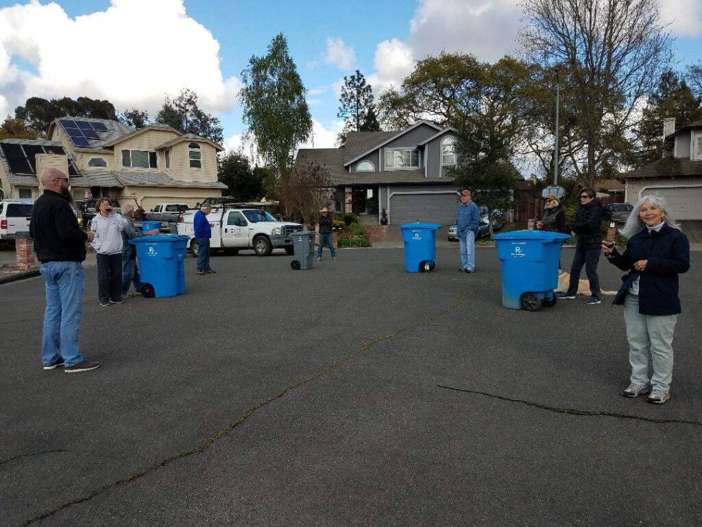Cul-de-sac neighbors on Santa Rosa's Meridian Circle practice social distancing and savor liquid refreshment at their first Trash (can) Talk Tuesday gathering. (Gayle Pickrell)