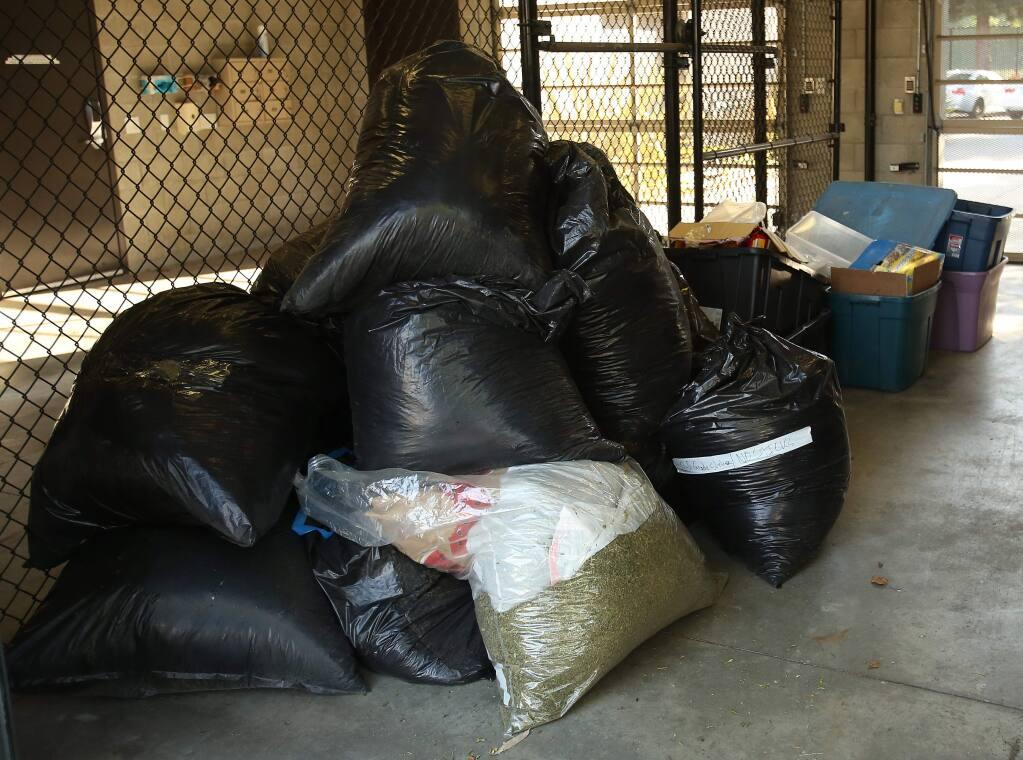 Drug paraphernalia was taken into evidence after Cotati police served a search warrant Friday, Sept. 5, 2014. (Crista Jeremiason/The Press Democrat)