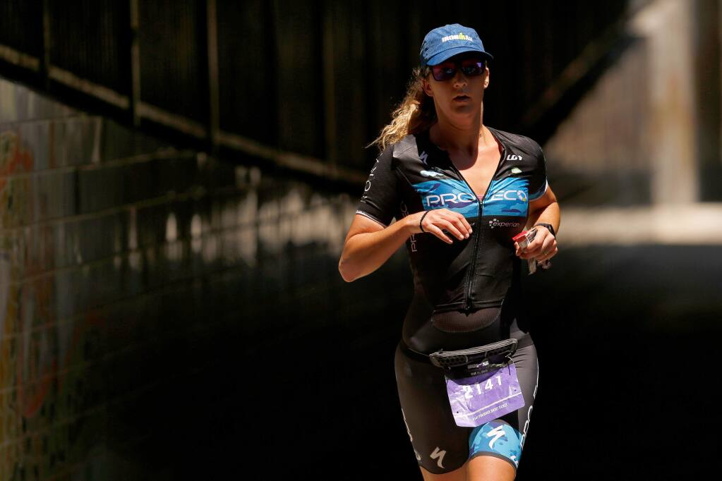 Triathlete Kylie Chevalier of Laguna Hills runs down Prince Memorial Greenway during Ironman Santa Rosa, in Santa Rosa, California, on Saturday, May 11, 2019. (Alvin Jornada / The Press Democrat)