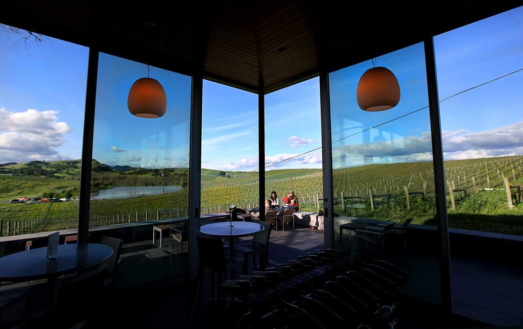 Sweeping views of the carneros region of Sonoma and Napa County are afforded from the modern tasting room and deck at Cuvaison Winery. (Kent Porter / Press Democrat) 2010