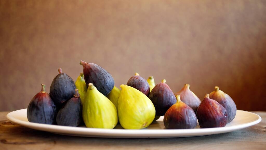 A platter of assorted figs, including the Brown Turkey Fig, at the far right. (Alvin Jornada / The Press Democrat)