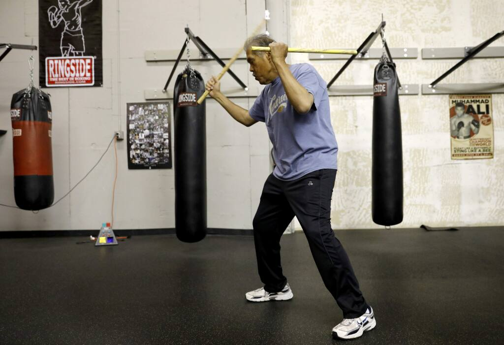 Rene Latosa, a grand master of Filipino martial arts, works out at Ringtime Fitness in Santa Rosa on Tuesday, May 15, 2018. (Beth Schlanker/ The Press Democrat)