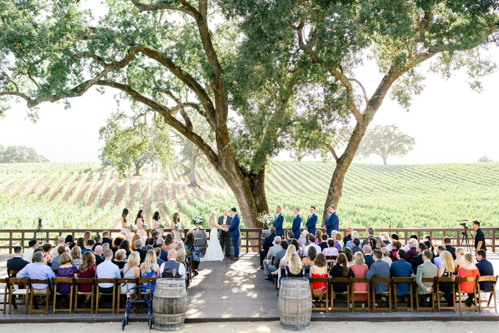 A view of pre-COVID-19 ceremonies: Sonoma Valley wineries Viansa and B.R. Cohn, whose parent company is Vintage Wine Estates, together hold more than 100 weddings each year. (Corinna Rose Photography)