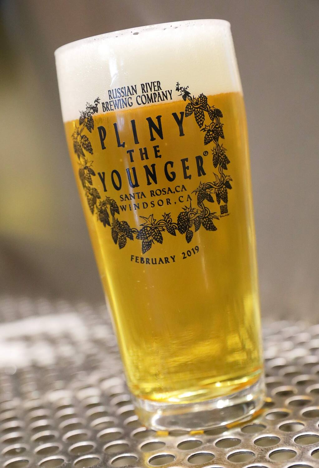 A souvenir glass commemorating this year's Pliny the Younger release. (Christopher Chung/ The Press Democrat)