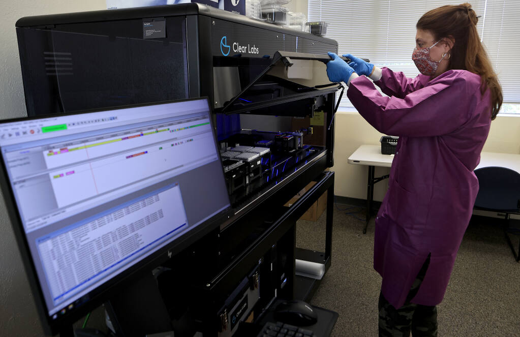 Lisa Critchett, a county health microbiologist checks the progress of genetic sequencing for COVID-19 testing samples in state of the art genotyping equipment, Tuesday, July 13, 2021, at Sonoma County Public Health in Santa Rosa. (Kent Porter / The Press Democrat)