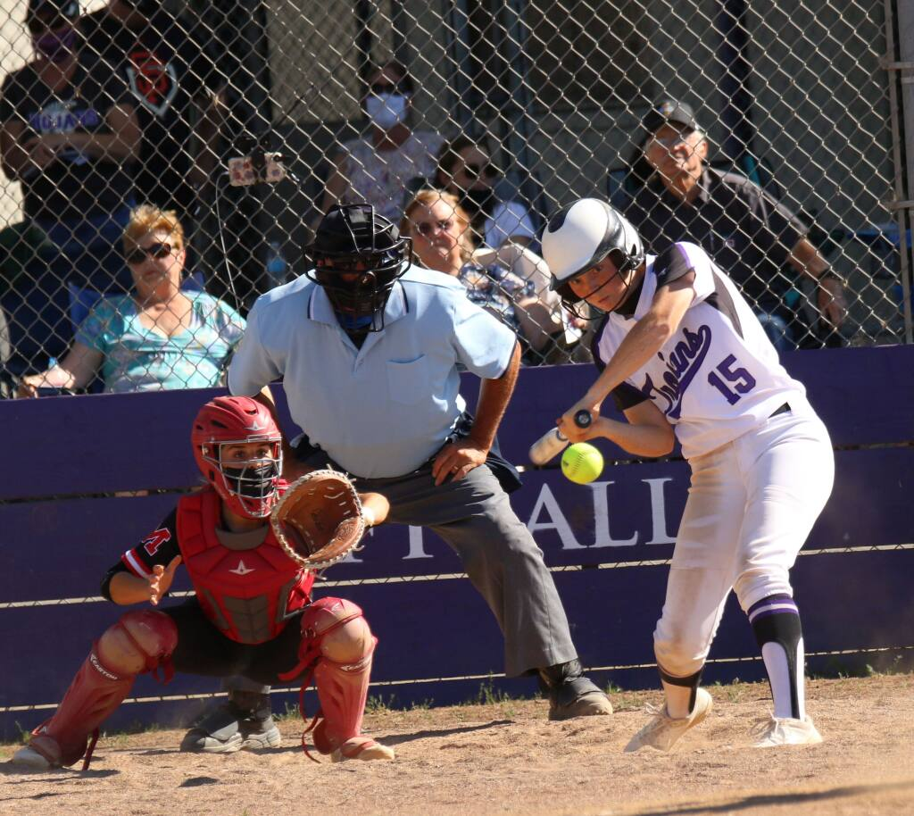 Logan Pomi connects for a home run in Petaluma's win over Montgomery on May 10, 2021. (DWIGHT SUGIOKA FOR THE ARGUS-COURIER)