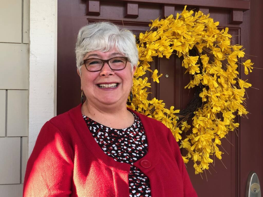 North Bay Leadership Council CEO Cynthia Murray stands in front of her Petaluma home. She discovered that a bird found safe harbor nesting in her door wreath. (Susan Wood / North Bay Business Journal)