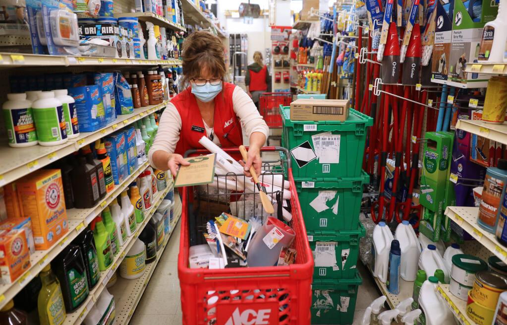 Christy Simmons works on restocking the shelves at Sebastopol Hardware Center in Sebastopol on Friday, July 3, 2020. (Christopher Chung / The Press Democrat)