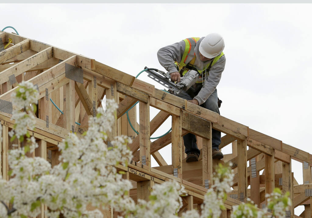 FILE - In this Feb. 8, 2019 file photo, work is done on an apartment building under construction in Sacramento, Calif. California lawmakers have advanced the second of two measure's designed to ease local zoning ordinances for home construction. Spurred by an affordable housing shortage, spiking home prices and intractable homelessness, California lawmakers on Thursday, Aug. 26, 2021,  advanced the second of two measures designed to cut through local zoning ordinances. (AP Photo/Rich Pedroncelli, File)