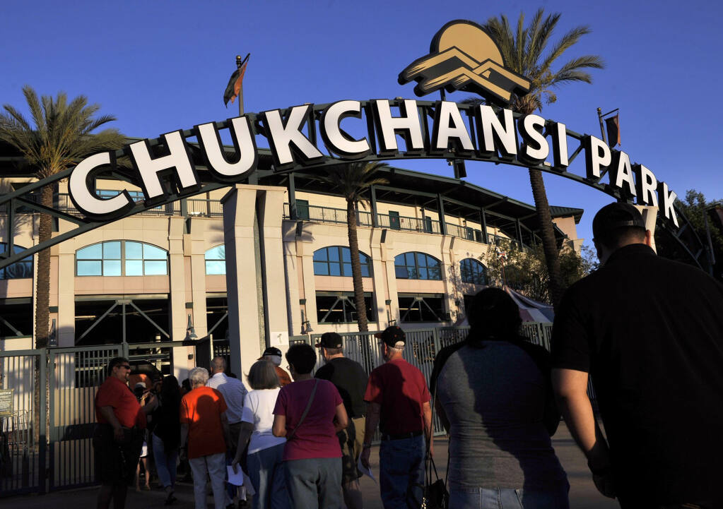 FILE - In this Sept. 18, 2015, file photo, fans arrive at Chukchansi Park in Fresno, Calif., for a minor-league baseball game between the Fresno Grizzlies and the Round Rock Express. Fresno authorities say a man died shortly after competing in a taco-eating contest at a Grizzlies game. The son of a California man who choked to death during the amateur taco eating contest at a minor league baseball game is suing the event's organizers for negligence. (Eric Paul Zamora/The Fresno Bee via AP, File)