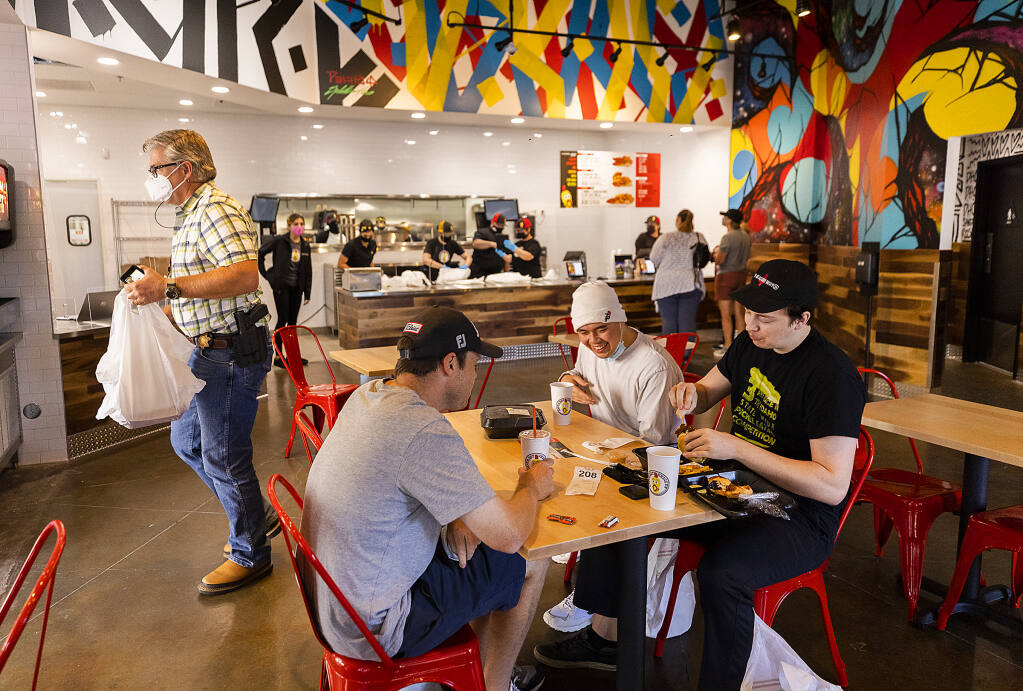 The new Dave's Hot Chicken restaurant in Santa Rosa held a soft opening Wednesday, Sept. 22, with invited guests as an opportunity to train staff. (John Burgess / The Press Democrat)