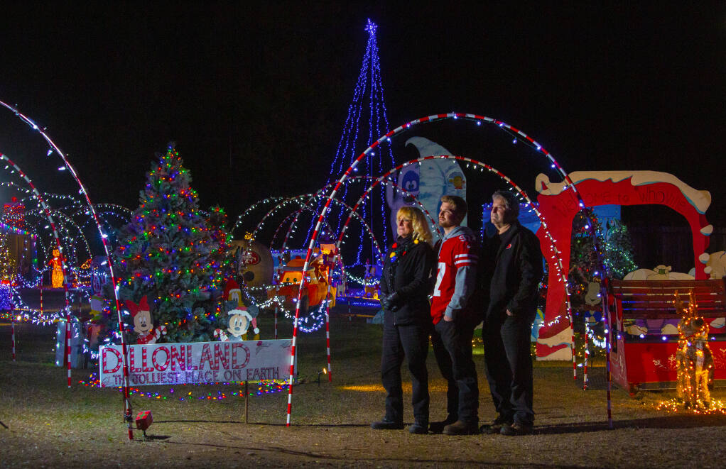 From left, Karen, Dillon and Gary Stall at their Christmas themed, walk-through holiday fantasyland on Grove Street, on Wednesday, Dec. 2. (Photo by Robbi Pengelly/Index-Tribune)