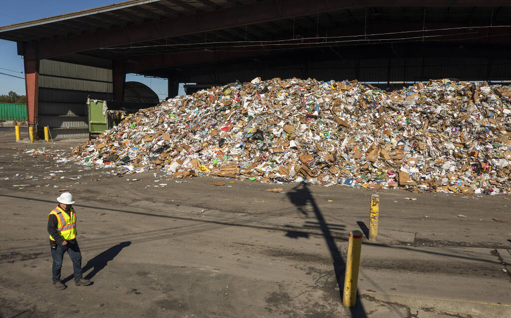 Mounds of recycling wait to be separated and processed at the Recology Sonoma Marin Recycling Center on Feb. 4, 2021. (Photo by John Burgess/The Press Democrat)