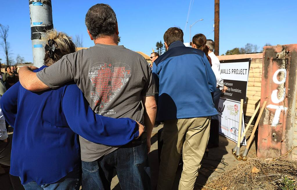 Curtis and Ruth Martin lost their home to the Tubbs fire and were on hand at Crestview Drive and Hopper Ave., Thursday, Nov. 8, 2018 for the groundbreaking of the new Coffey Park wall damaged during the fire in October of 2017. (Kent Porter / The Press Democrat) 2018