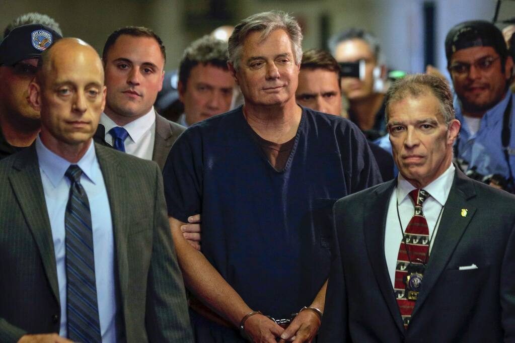 FILE - In this June 27, 2019 file photo, Paul Manafort arrives in court in New York. A judge has thrown out Paul Manafort's New York mortgage fraud case on double jeopardy grounds. Manafort's lawyers had argued that the state charges should have been dismissed because they involve some of the same allegations as federal cases that have landed Manafort behind bars. (AP Photo/Seth Wenig, File)