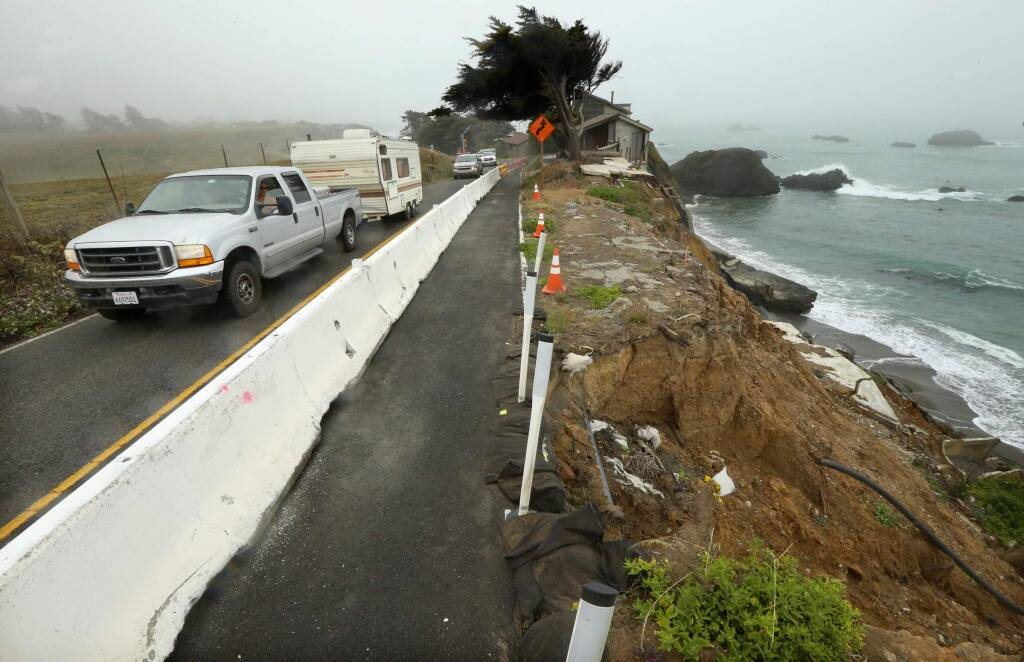 Caltrans was forced to install lights and close off the southbound lane of traffic as the coastline continues to erode at Gleason Beach along Hwy 1 north of Bodega Bay. (JOHN BURGESS/The Press Democrat)
