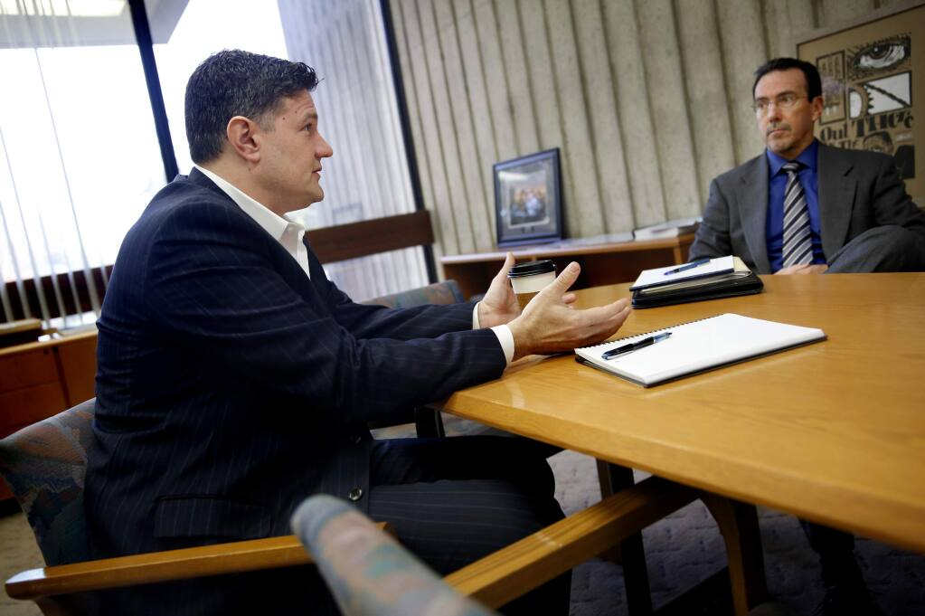 Santa Rosa City Manager Sean McGlynn, left, talks with David Gouin, the director of economic development and housing, in January of 2015.  (Beth Schlanker/ The Press Democrat, 2015)