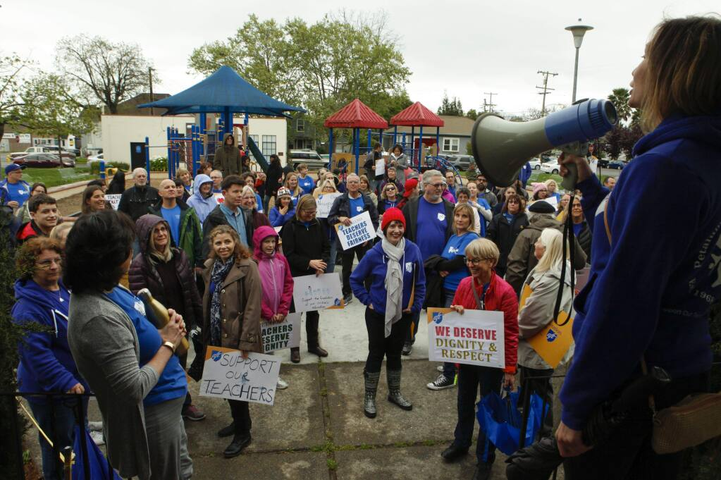 Petaluma, CA. Tuesday, April 11, 2017._ Suzanne Garcia, PFT Chief Negotiator and second grade teacher at McNear Elementary speaks to teachers and their supporters at Walnut Park where they met before marching to the district office to demand better pay.(CRISSY PASCUAL/ARGUS-COURIER STAFF)