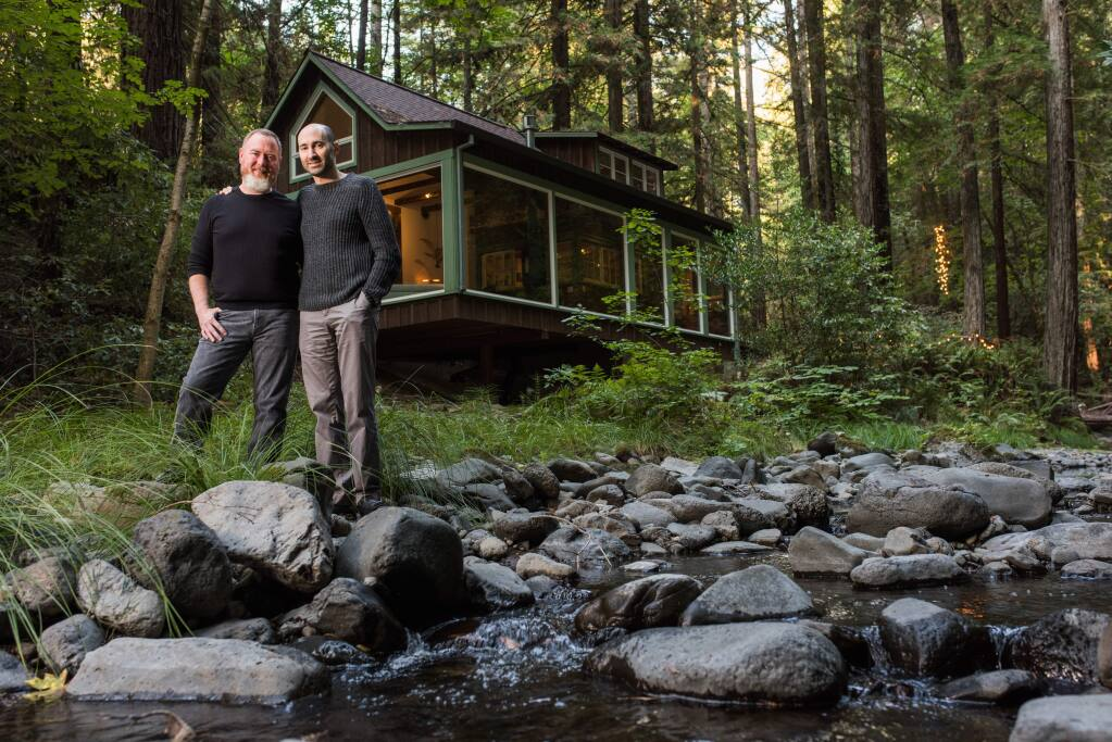 Homeowners Josh Feldman, right, and Britton Watkins played key roles in the redesign of their vintage cabin retreat. (Rebecca Chotkowski)
