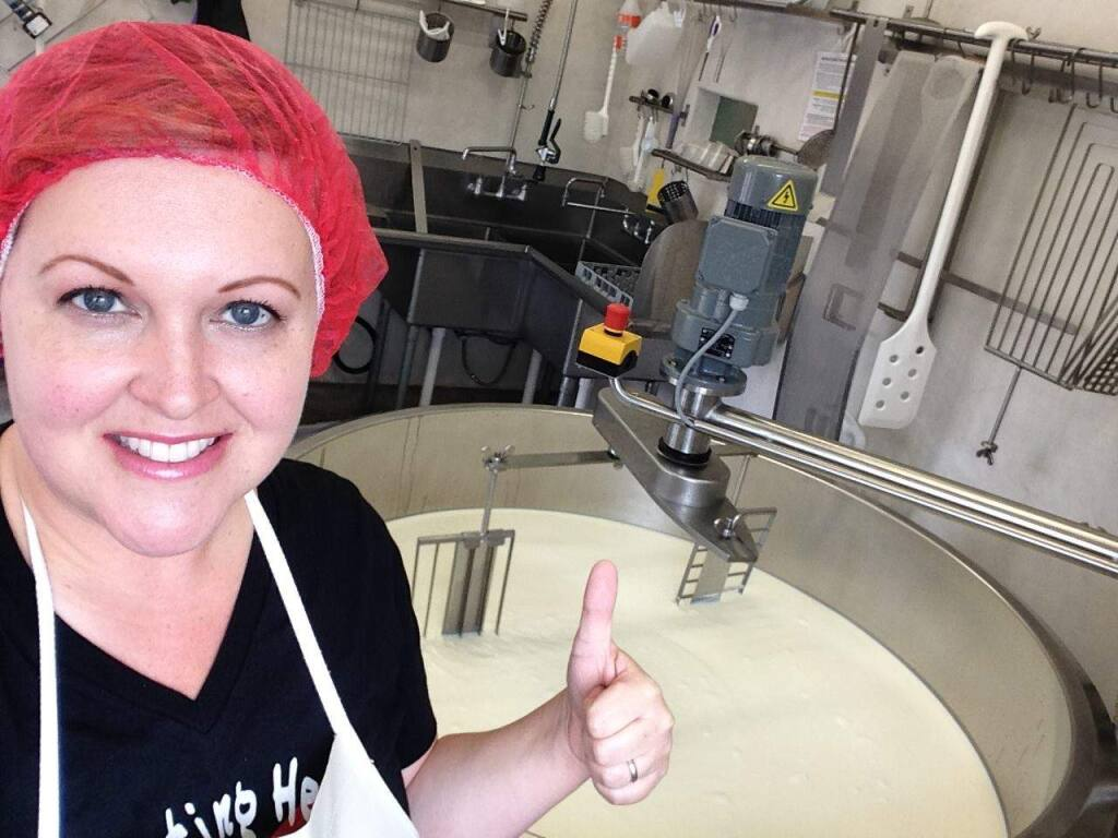 Seana Doughty, founder of Bleating Heart Cheese, works with a vat in the creamery on the 1,000-acre Thorton Ranch in Tomales. (BleatingHeartCheese.com)