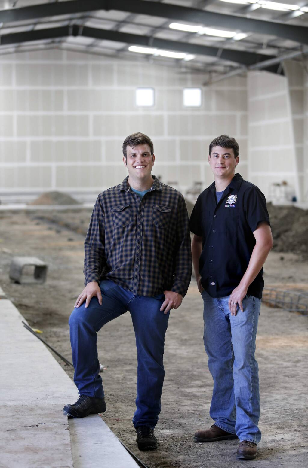Christopher Jackson, owner of Seismic Brewing Co., left, and Andy Hooper, Brewmaster and Director of Operations, at the building which will house Seismic Brewing Co. Photo taken in Santa Rosa, on Thursday, May 26, 2016. (BETH SCHLANKER/ The Press Democrat)