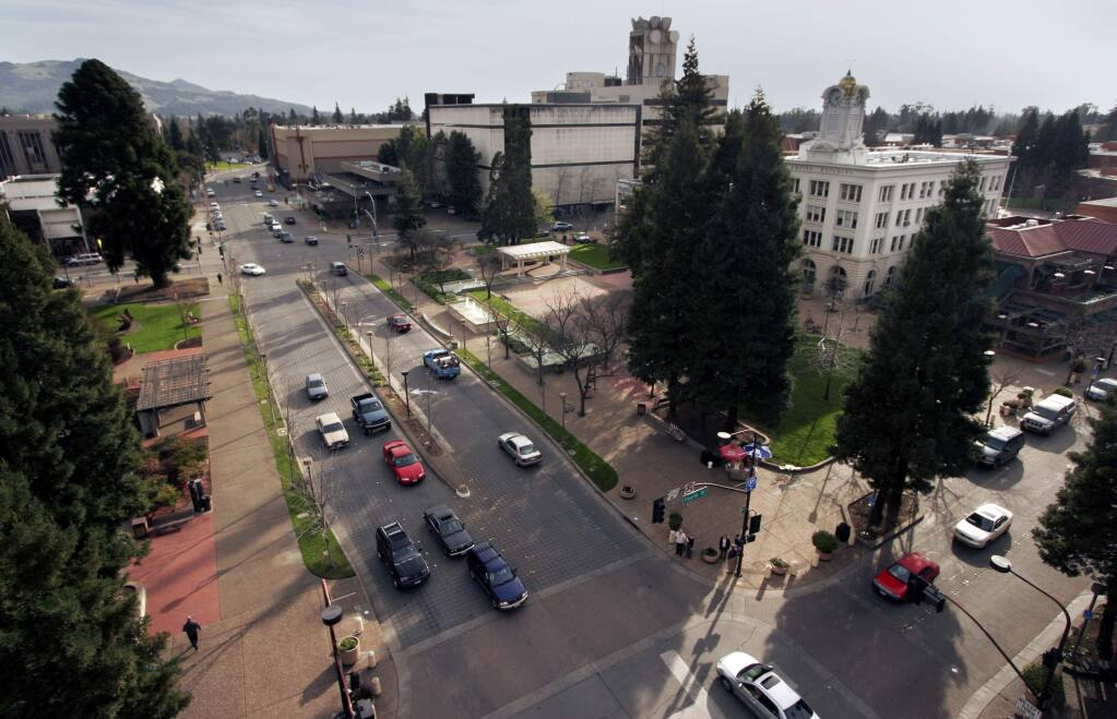Construction workers install Silva Cells around Courthouse Square in Santa Rosa, on Wednesday, August 31, 2016. The cells use soil volumes to support large tree growth and provide stormwater management. (Christopher Chung/ The Press Democrat)