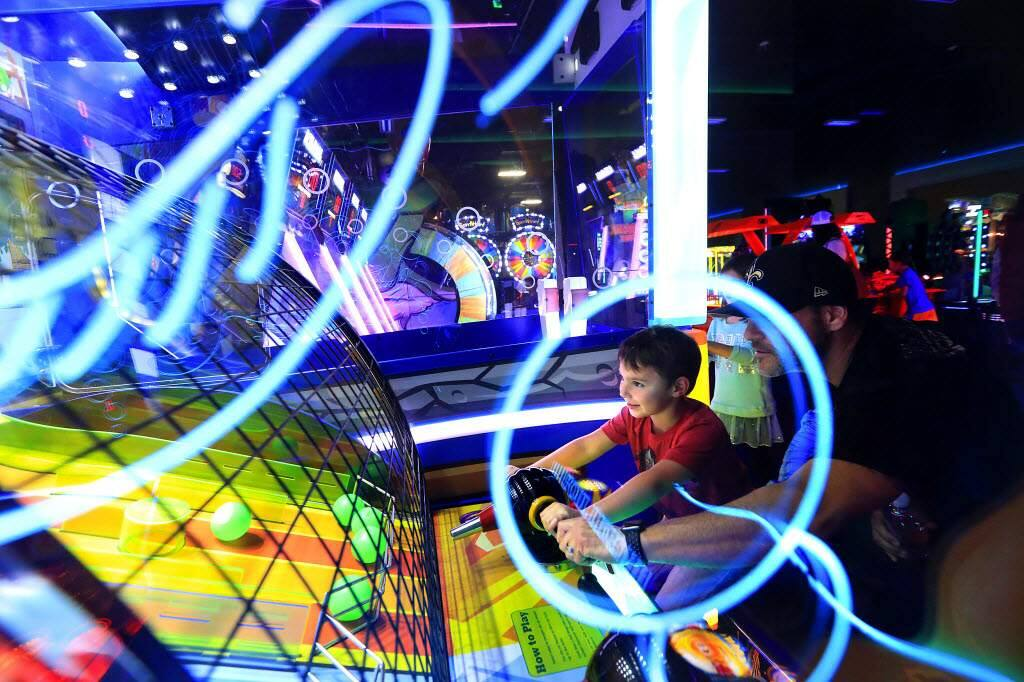 Ethan Simon, 4, plays a game with his dad Joe in the Game On Arcade at Epicenter Sports & Entertainment Center in Santa Rosa. (John Burgess/The Press Democrat)