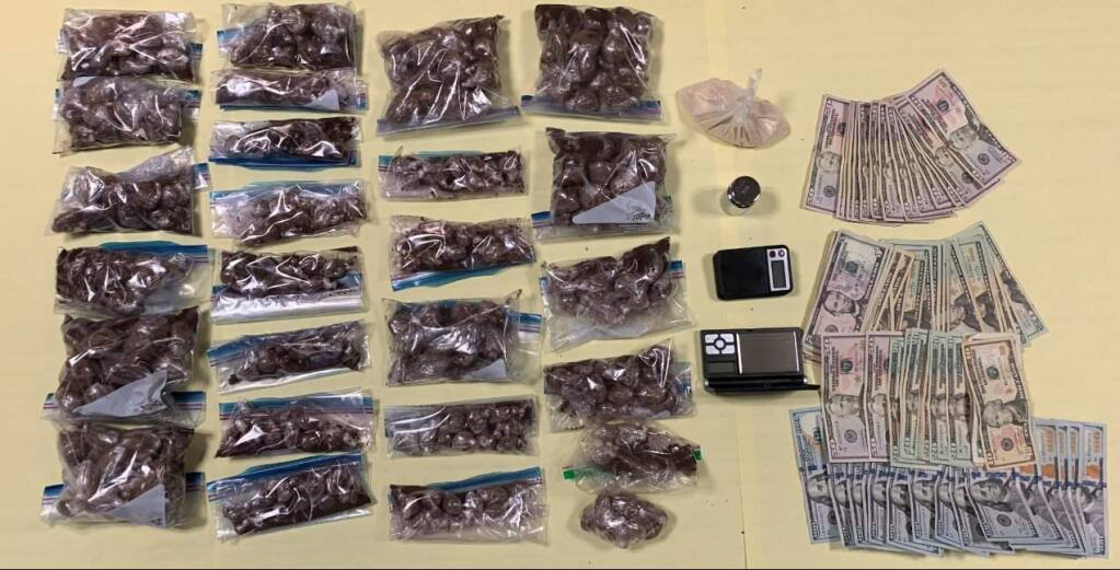 Drugs, cash and other items police say they found during searches of houses and vehicles in Santa Rosa and Rohnert Park, leading to the arrest of four Sonoma County men on Wednesday, Dec. 11, 2019. (SANTA ROSA POLICE DEPARTMENT/ FACEBOOK)