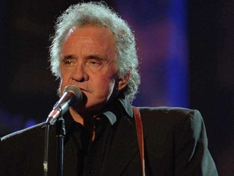 In this Sept. 2, 1995 file photo, Johnny Cash performs during his segment of the Concert for the Rock and Roll Hall of Fame in Cleveland. (AP Photo/Mark Duncan)