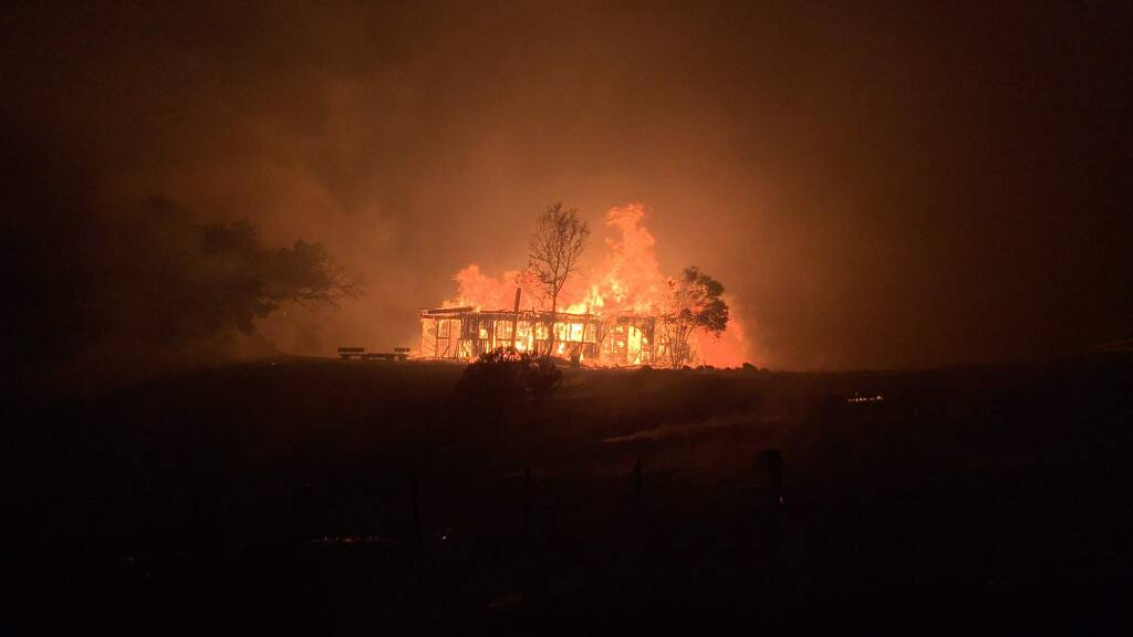 Santa Rosa's historic round barn burns in the Fountaingrove area after 3 a.m. on Monday, Oct. 9, 2017. (KENT PORTER/ The Press Democrat)