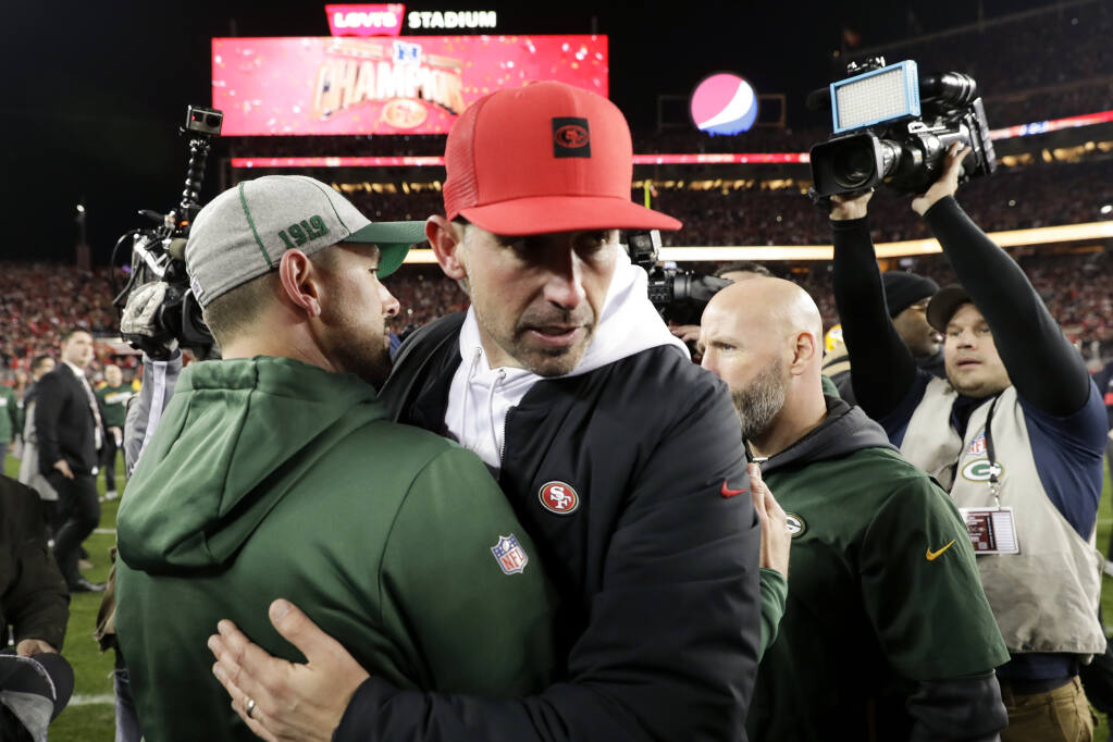 San Francisco 49ers head coach Kyle Shanahan, right, hugs Green Bay Packers head coach Matt LaFleur after the 49ers won the NFC championship game on Sunday, Jan. 19, 2020, in Santa Clara. (Matt York / ASSOCIATED PRESS)