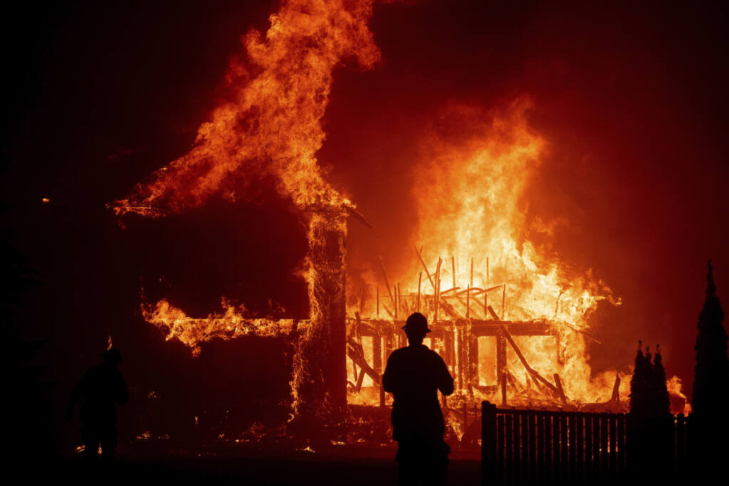 California's wildfires have triggered premium increases, nonrenewals and moratoriums on cancellation of homeowners insurance policies. (NOAH BERGER / Associated Press, 2018)