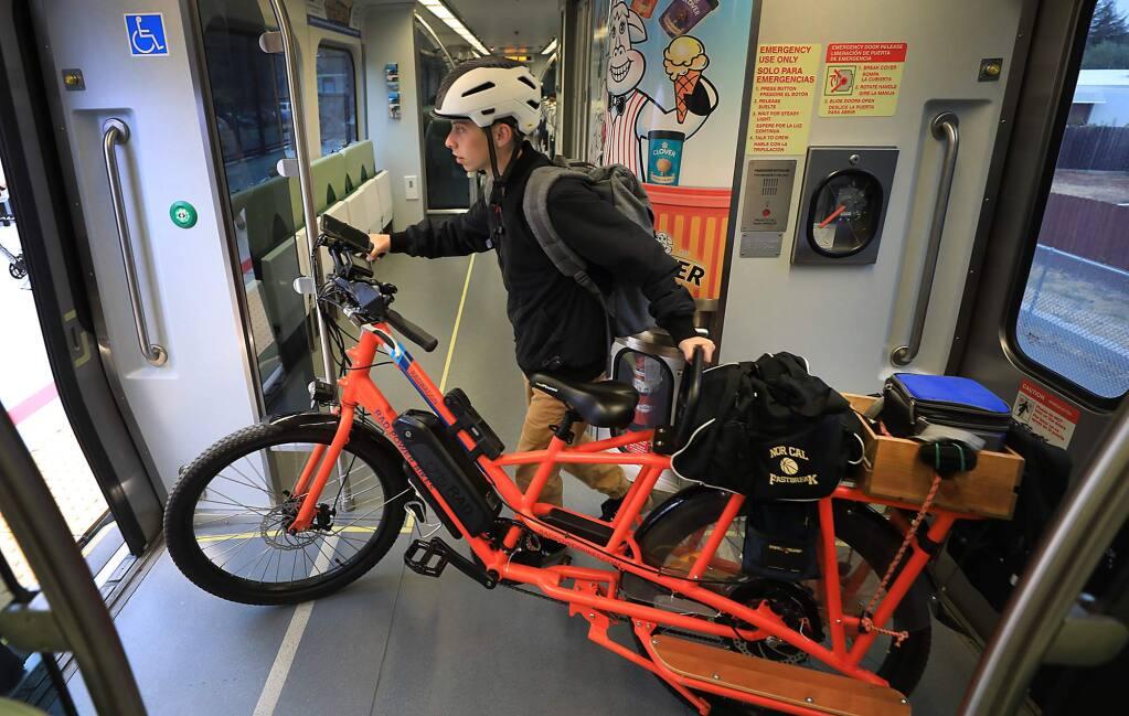 Windsor resident Ben Alexander makes Rohnert Park his stop on the SMART commuter train on Friday, Aug. 17, 2018. (KENT PORTER/ PD)
