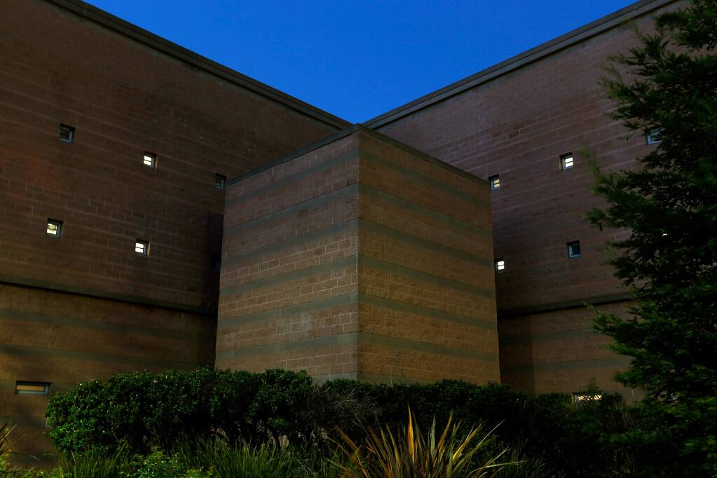 Interior lights shine through small exterior windows at the Sonoma County Sheriff's Office Main Adult Detention Facility in Santa Rosa, California, on Thursday, March 30, 2017. (ALVIN JORNADA/ PD)