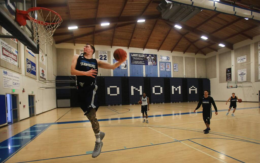 Luke Cochran on his way to a dunk at the tail end of Sonoma State University's men's basketball practice, Thursday Feb. 2, 2016 in Rohnert Park. (Kent Porter / Press Democrat)