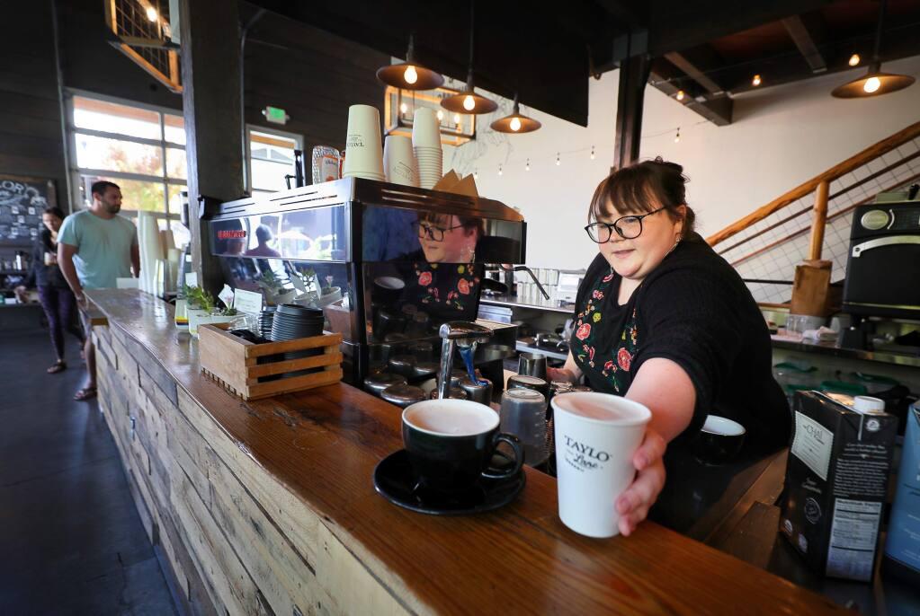 Barista Evie Holl serves up an order at Taylor Lane Organic Coffee, at The Barlow in Sebastopol on Friday, September 27, 2019. (Christopher Chung/ The Press Democrat)