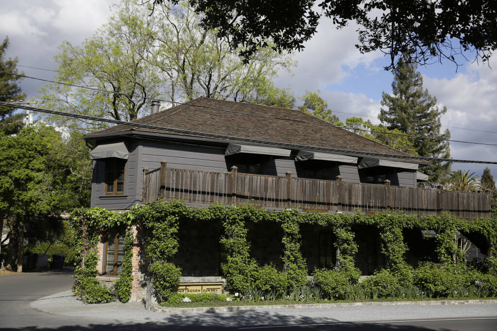 "FILE - This Thursday, March 19, 2020 file photo, is The French Laundry restaurant in Yountville, Calif. California Gov. Gavin Newsom on Monday, Nov. 16, 2020, apologized for what he called ""a bad mistake"" in attending a birthday party that broke the very rules that he has been preaching to slow the spread of the coronavirus. He has suffered severe political backlash since it surfaced Friday that he and his wife attended the party Nov. 6 with a dozen friends at the pricy French Laundry restaurant in wine country north of San Francisco. (AP Photo/Eric Risberg,File)"