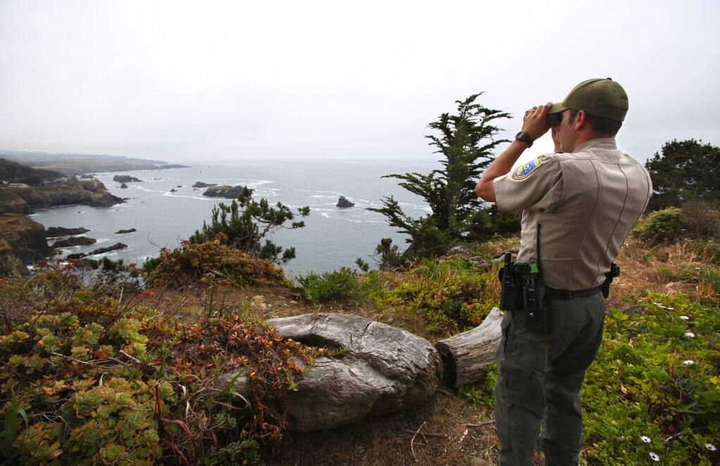 Fish and Wildlife warden Don Powers looks for abalone divers along the Mendocino coast, near Little River on Friday, May 22, 2015. (Christopher Chung/ The Press Democrat) Sonoma Magazine