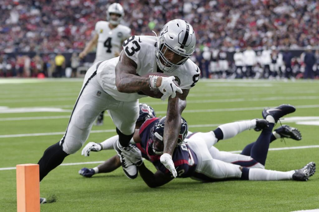 Oakland Raiders tight end Darren Waller scores a touchdown against the Houston Texans during the first half Sunday, Oct. 27, 2019, in Houston. (AP Photo/Michael Wyke)