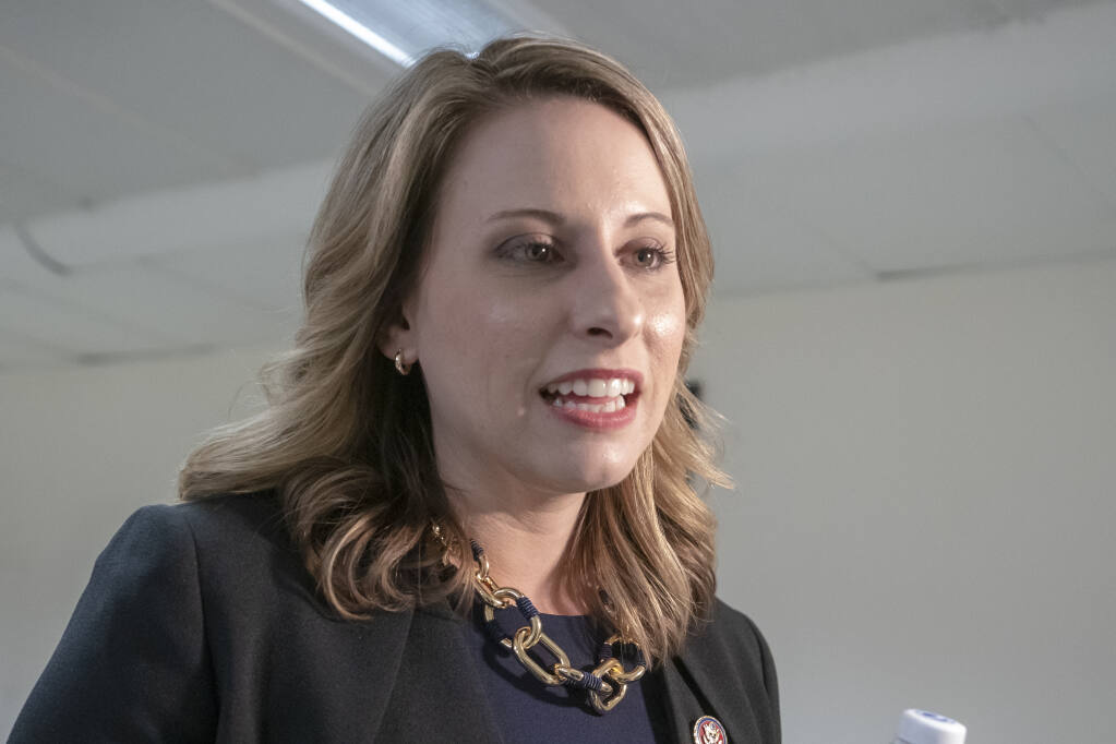 FILE - In this April 3, 2019 file photo Rep. Katie Hill, D-Calif., is seen on Capitol Hill in Washington. A lawsuit by former U.S. Rep. Hill against the Daily Mail was dismissed Wednesday, April 7, 2021, by a judge who said the tabloid was protected on First Amendment grounds when it published nude photos of her. (AP Photo/J. Scott Applewhite,File)