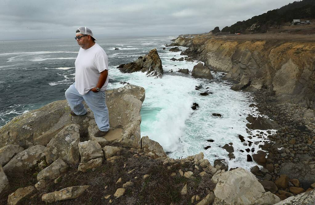 JOHN BURGESS / The Press Democrat RETURN TO ROOTS: Randy Marrufo, transportation planner for the Kashia Band of Pomo Indians, stands on a stretch of coastline at the northern edge of Salt Point State Park that is being acquired by a group of private and public agencies and will be transferred to the Kashia, restoring the tribe's ancestral lands.
