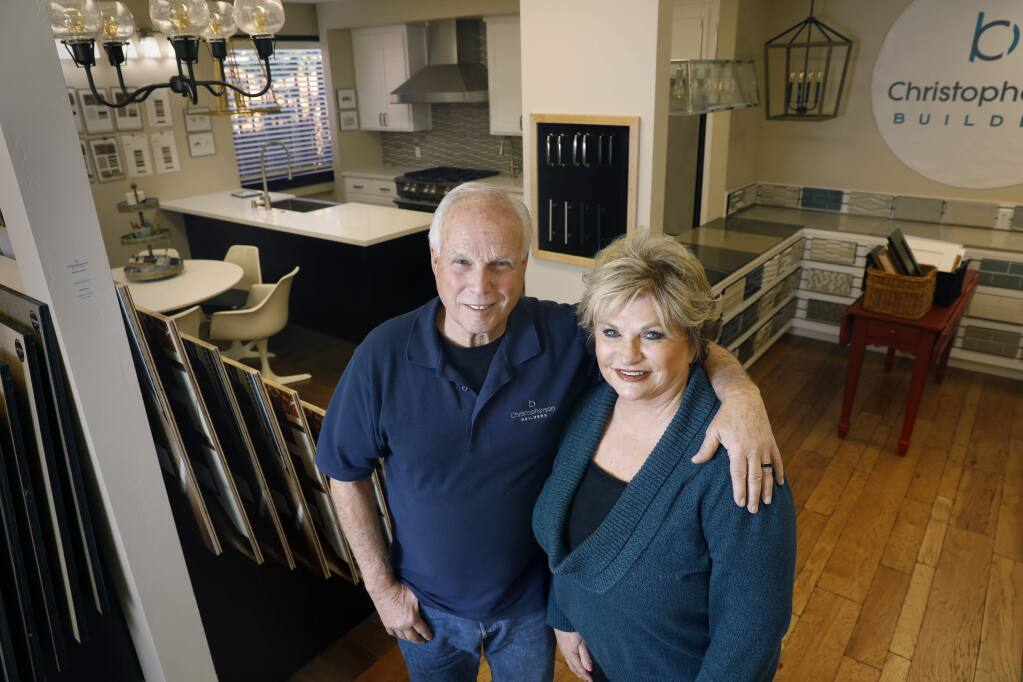 Brenda and Keith Christopherson of Christopherson Builders stand in a showroom of interior finishes at their design studio in Santa Rosa on Tuesday, January 22, 2019. (BETH SCHLANKER/ The Press Democrat)