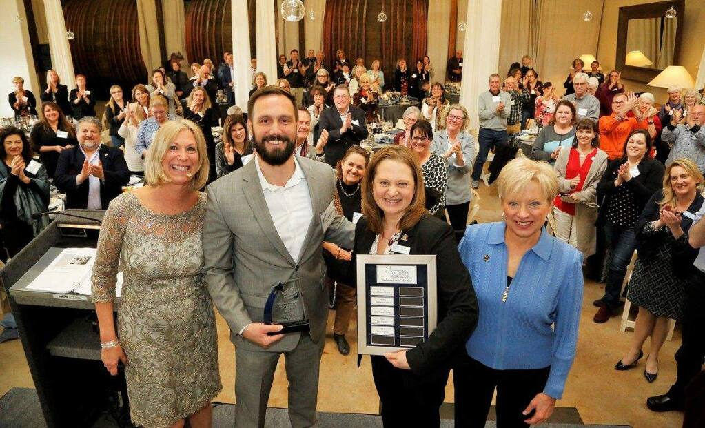 Tony Bucklen, second from left, general manager of the burned-down Hilton Sonoma Wine Country, gets a standing ovation as he accepts the Certified Tourism Ambassador of the Year award on Feb. 22, 2018. He's congratulated by, from left, Mo McElroy, Sonoma County Tourism, Nicole Bradin, Sonoma County Tourism, and Mickey Schaefer, Tourism Ambassador Institute. Bucklen is also Sonoma County's nominee for the national Certified Tourism Ambassador awards. (Sonoma County Tourism)