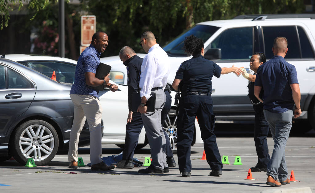 Santa Rosa police begin to gather information in a shooting in the parking lot of Bayer Park & Gardens at West Avenue and Rose Meadow Court, Wednesday, June 9, 2021, in Santa Rosa. (Kent Porter / The Press Democrat)