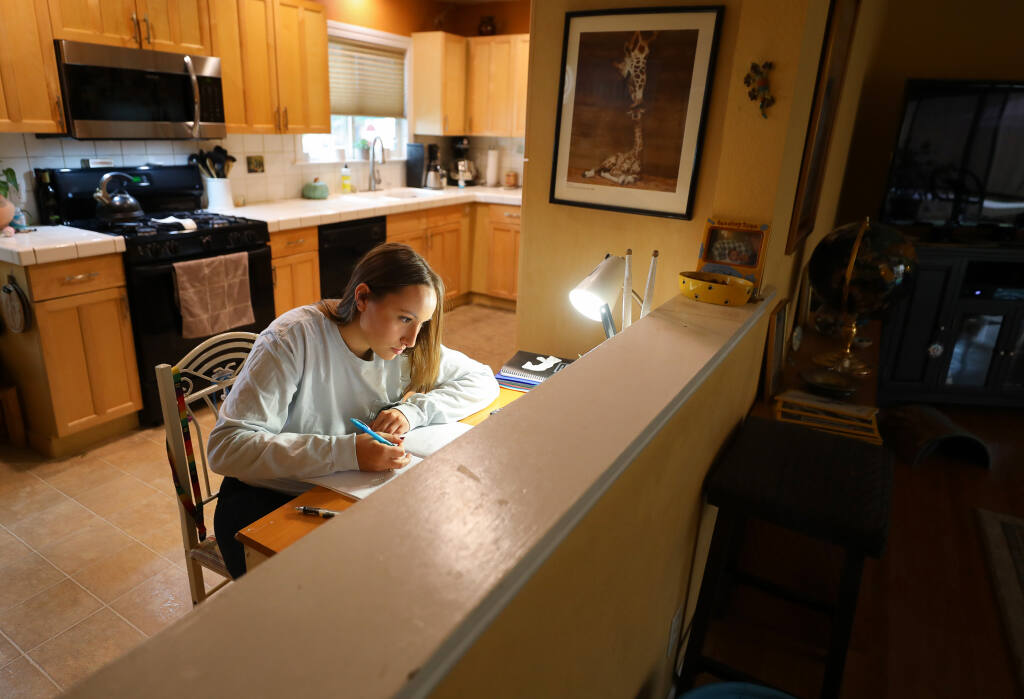 Rancho Cotate high school senior Lauren Poteet works on her Algebra 2 homework at her home in Rohnert Park on Friday, Nov. 13, 2020.  (Christopher Chung/ The Press Democrat)