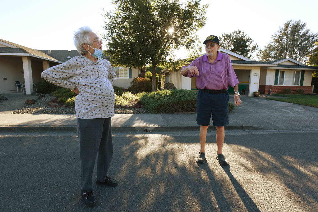 Sue Hattendorf, left, chatting with her neighbor Bill Grace after the two arrived back home after mandatory evacuation orders were lifted in Oakmont Village of Santa Rosa, Calif. on Sunday, October 4, 2020. Hattendorf spent most of the week at the Santa Rosa Veterans Memorial Hall while Grace slept at a friendÕs home in Santa Rosa.(Photo: Erik Castro/for The Press Democrat)