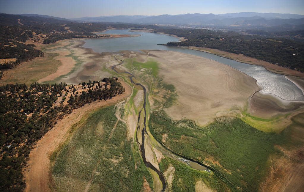 Lake Mendocino continues to recede, approaching levels not seen since 1976-77, Wednesday, Aug. 25, 2021. In the foreground is the east fork of the Russian River. (Kent Porter / The Press Democrat)