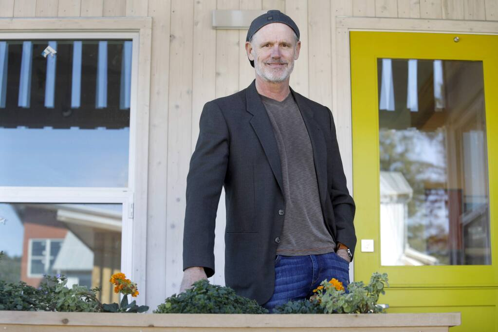 Chris Lynch of MAD Architecture designed Keller Court Commons, a new pocket neighborhood, on Thursday, February 15, 2018 in Petaluma, California . (BETH SCHLANKER/The Press Democrat)